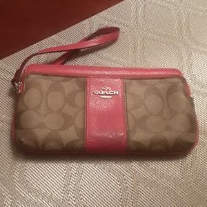 Coach double compartments wristless wallet.